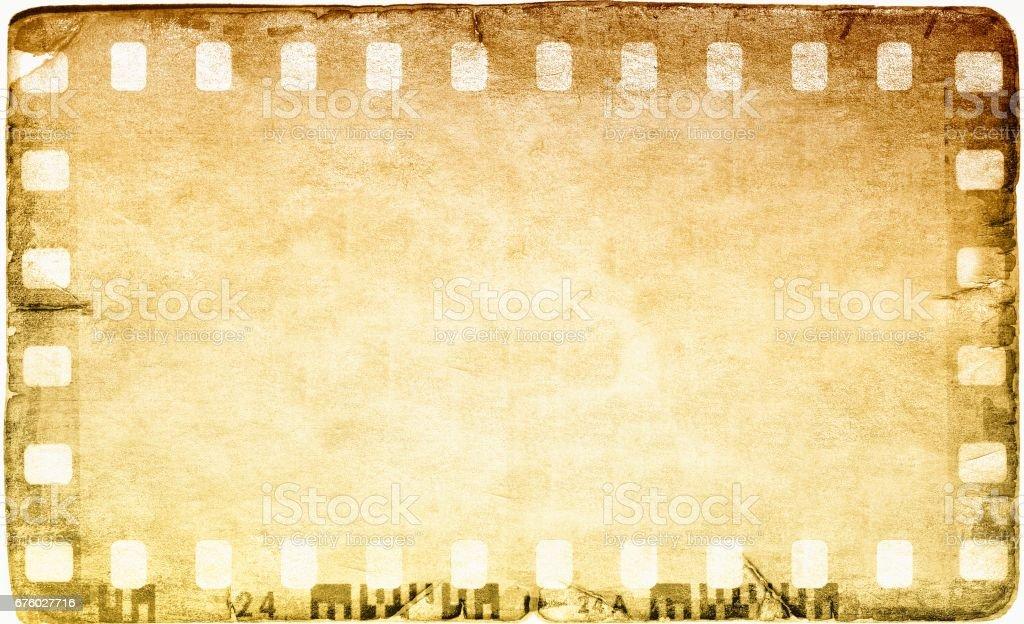 Royalty free film scratch texture background clip art vector vintage film strip frame on old and damaged paper background vector art illustration voltagebd Image collections