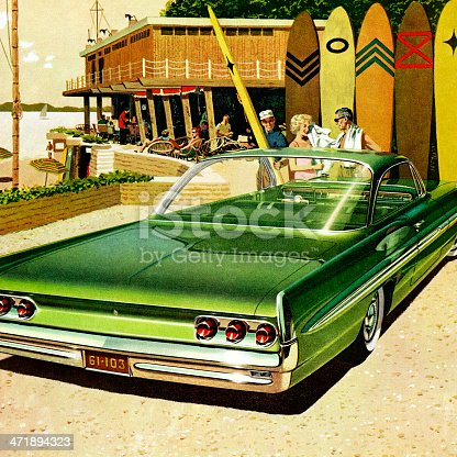 Couple at Beach in Front of Green Vintage Car