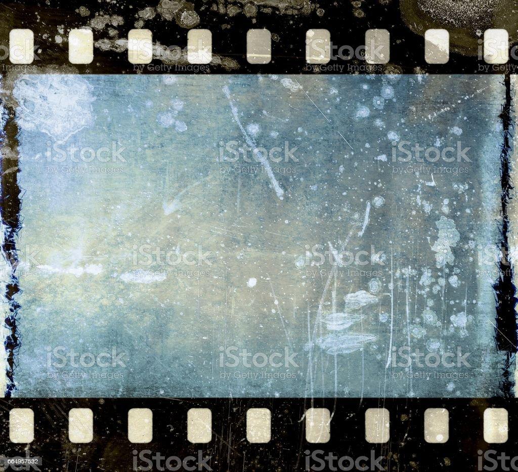 Vintage scratched film strip frame in blue tones. vector art illustration