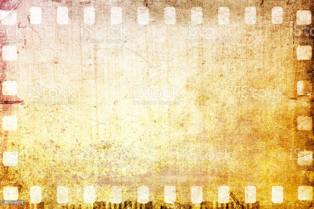 vintage sepia film strip frame on old and damaged paper