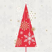 Vintage styled red christmas tree & sparkly white, gold and silver hanging snowflakes.
