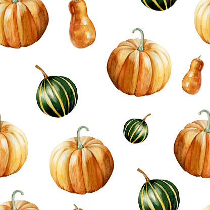 Watercolor hand painted seamless pattern with ripe orange and green pumpkins on light orange background.