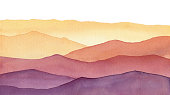 istock watercolor mountain shapes, hand painted background with hues of yellow gold and purple waves 1220606236