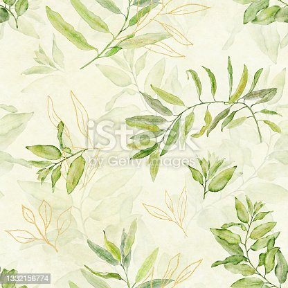 istock Watercolor seamless floral pattern with green and gold leaves on light yellow green background. 1332156774
