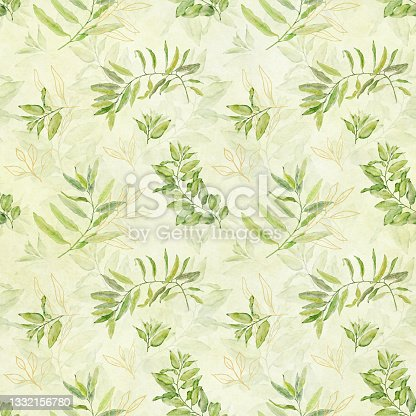 istock Watercolor seamless floral pattern with green and gold leaves on light yellow green background. 1332156780