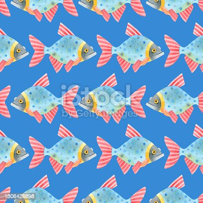 Watercolor seamless pattern of colorful fish. Cute funny carp fish (karps, crucians). Hand drawn texture of an ornament on a blue background. Ideal for textiles, packaging, wallpaper, websites, cards.