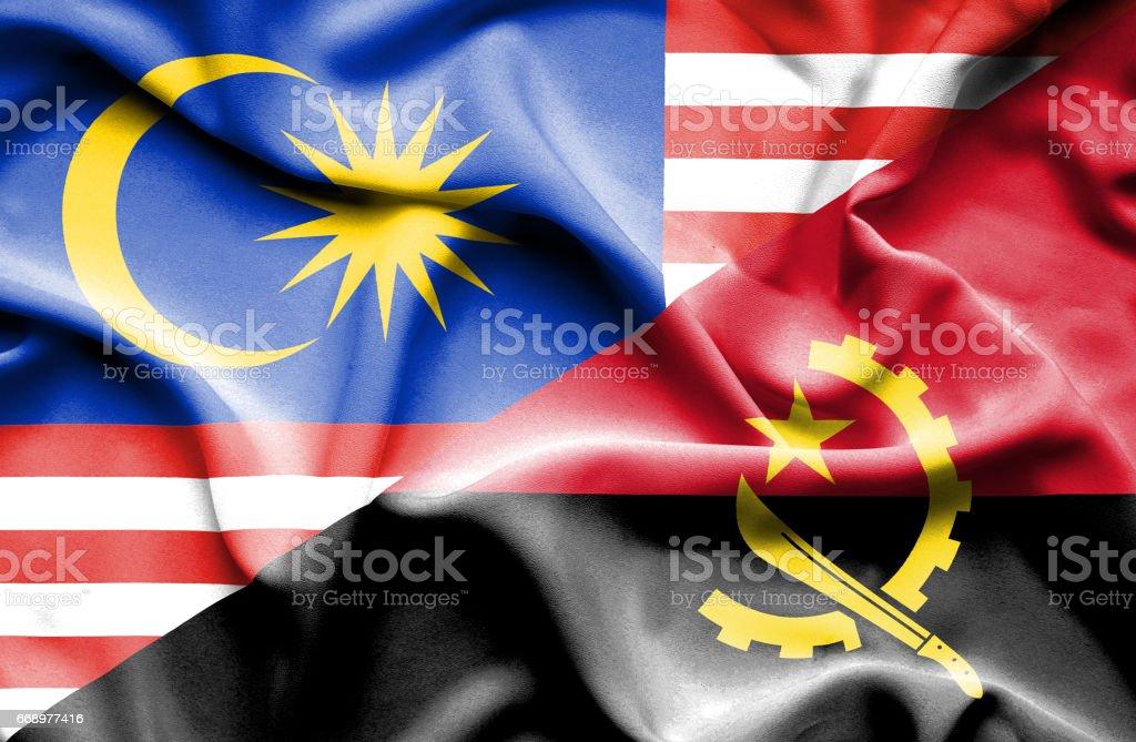 Waving flag of Angola and Malaysia waving flag of angola and malaysia - immagini vettoriali stock e altre immagini di accordo d'intesa royalty-free