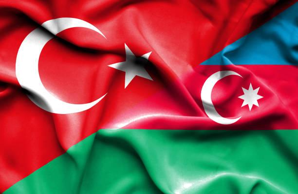 Waving flag of Azerbajan and Turkey Waving flag of Azerbajan and azerbaijan stock illustrations