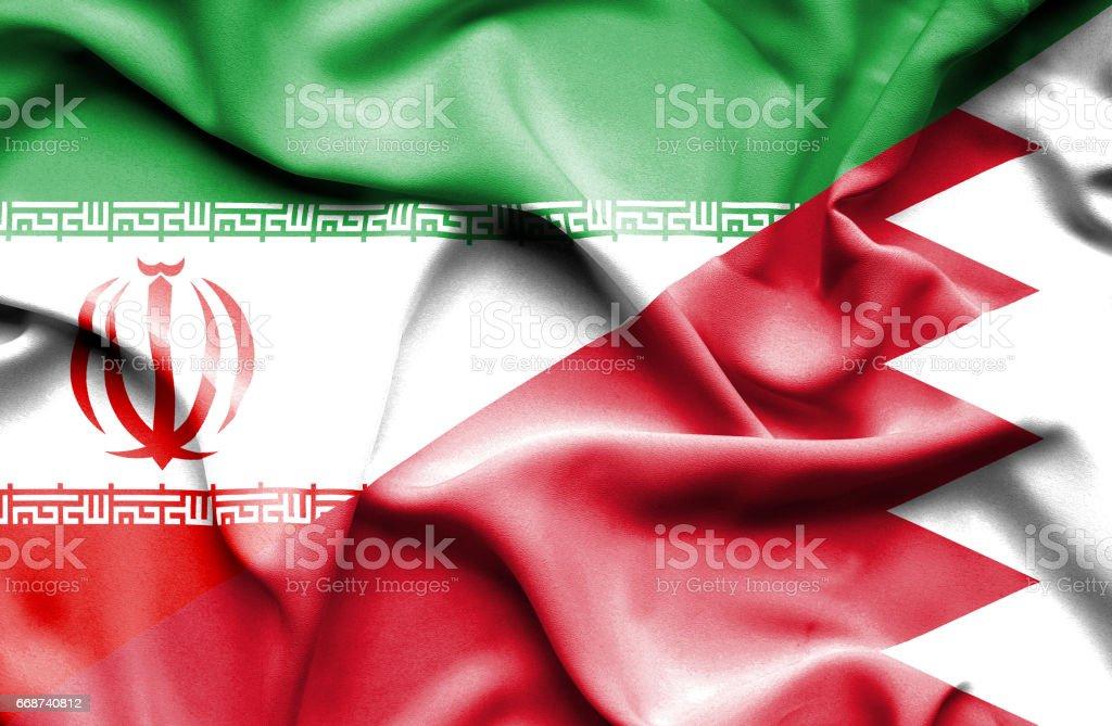 Waving flag of Bahrain and Iran vector art illustration