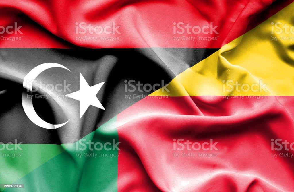 Waving flag of Benin and Libya waving flag of benin and libya - immagini vettoriali stock e altre immagini di accordo d'intesa royalty-free