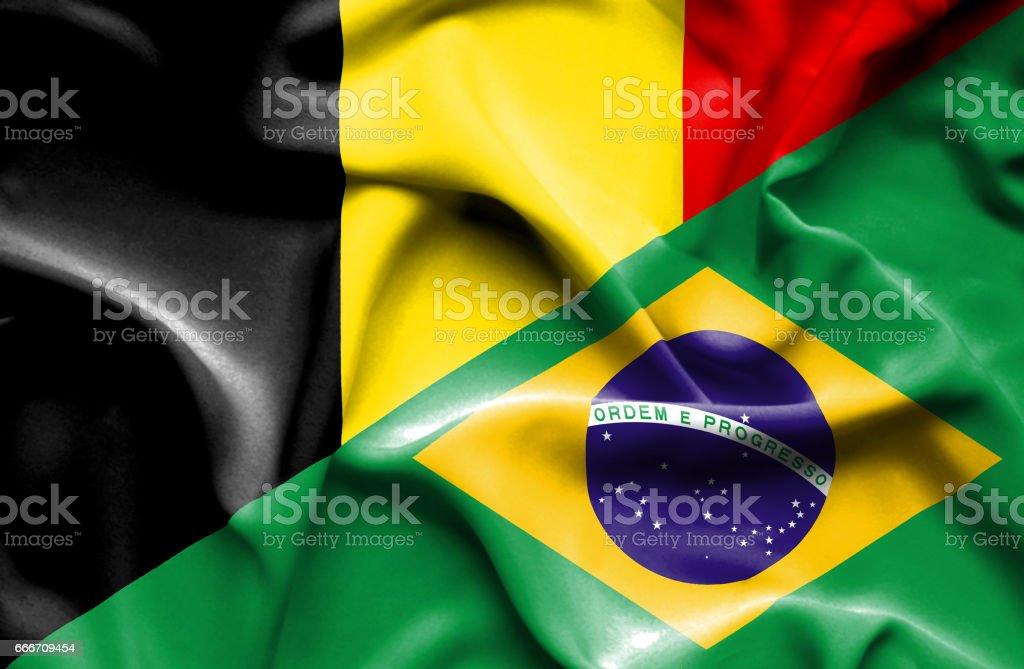 Waving flag of Brazil and Belgium vector art illustration