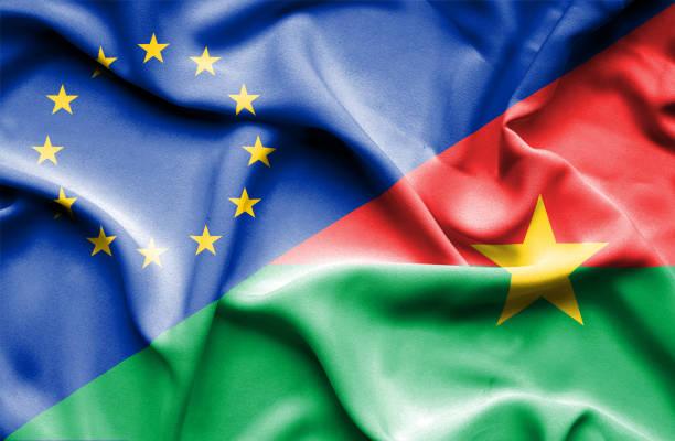 Waving flag of Burkina Faso and EU vector art illustration