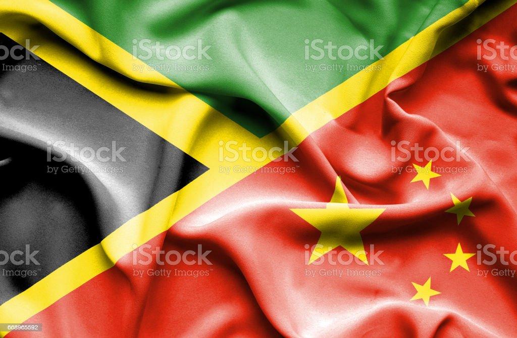 Waving flag of China and Jamaica waving flag of china and jamaica - immagini vettoriali stock e altre immagini di accordo d'intesa royalty-free