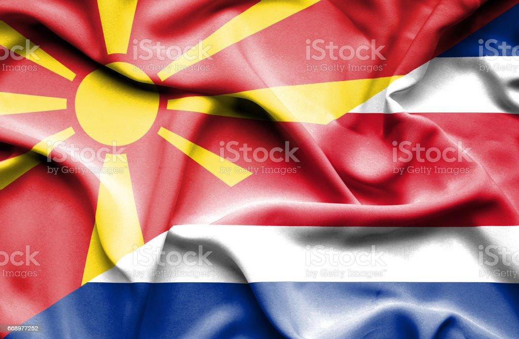 Waving flag of Costa Rica and Macedonia waving flag of costa rica and macedonia - immagini vettoriali stock e altre immagini di accordo d'intesa royalty-free