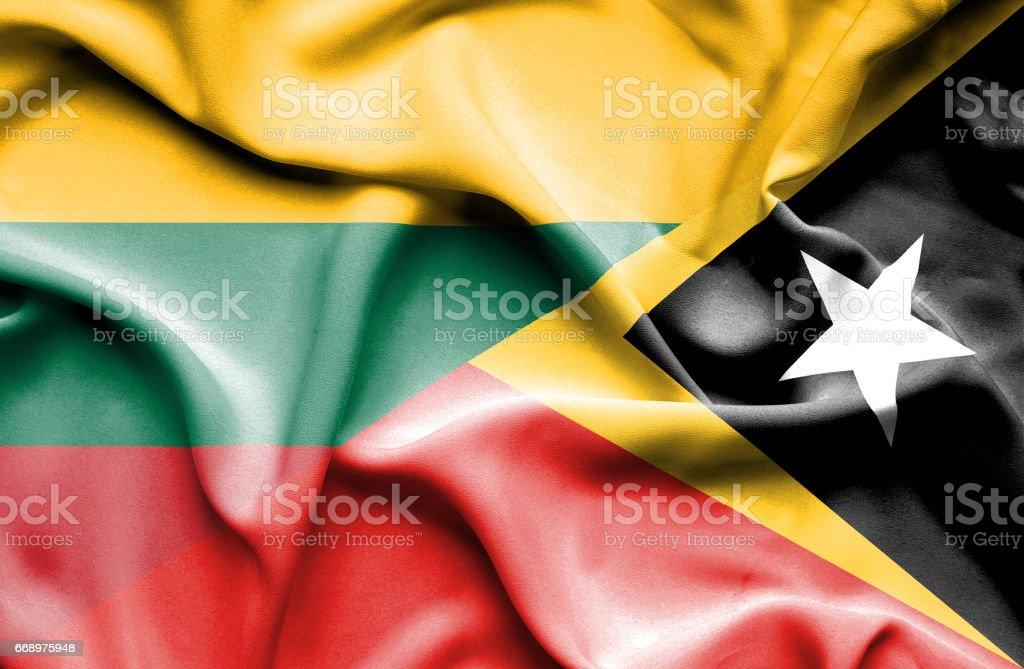 Waving flag of East Timor and Lithuania waving flag of east timor and lithuania - immagini vettoriali stock e altre immagini di accordo d'intesa royalty-free