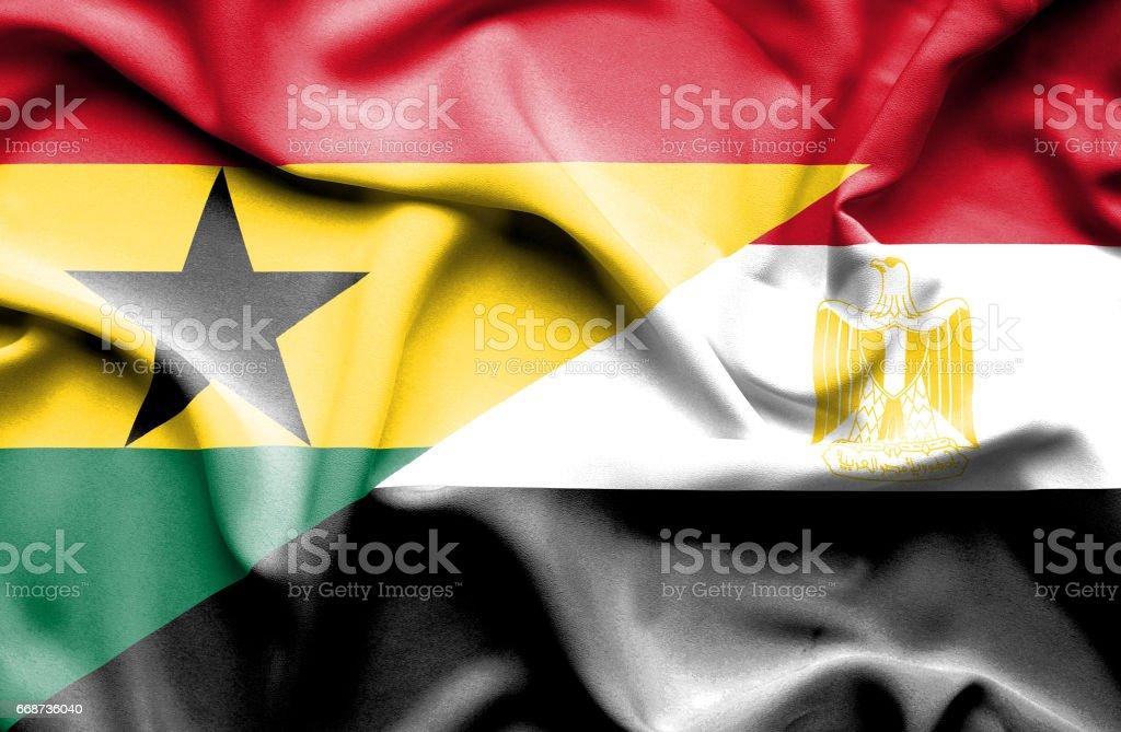 Waving flag of Egypt and Ghana - ilustración de arte vectorial