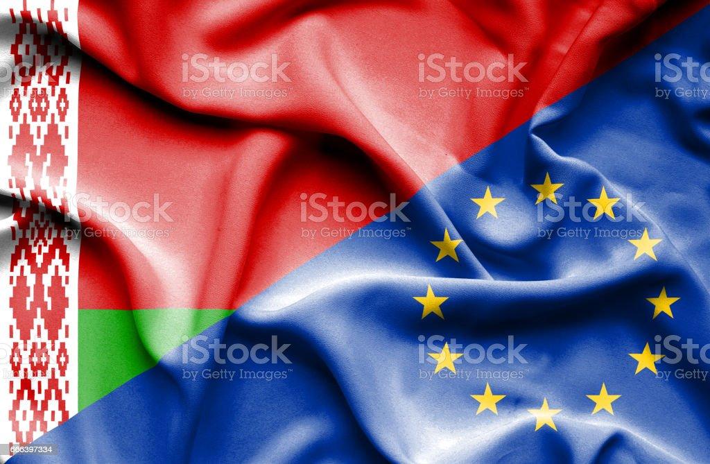 Waving flag of European Union and Belarus vector art illustration
