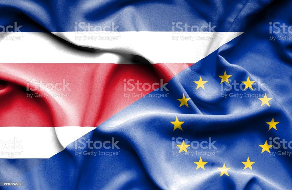 Acenando a bandeira da União Europeia e na Costa Rica - ilustração de arte em vetor