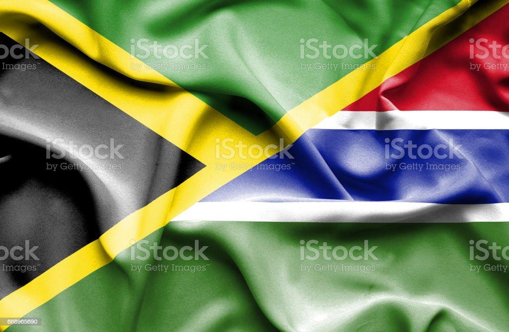 Waving flag of Gambia and Jamaica waving flag of gambia and jamaica - immagini vettoriali stock e altre immagini di accordo d'intesa royalty-free