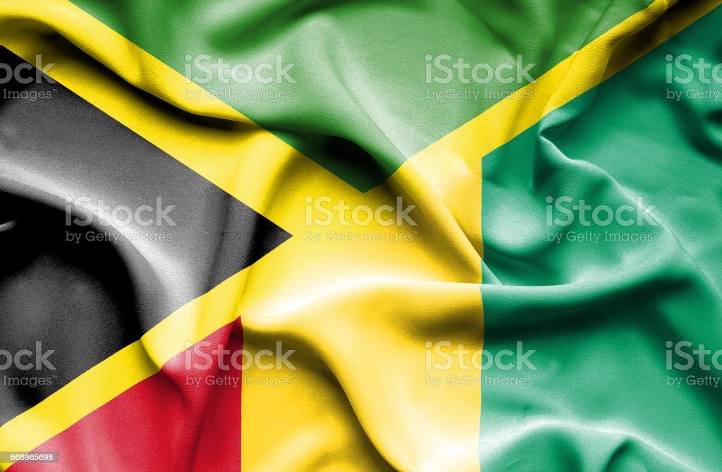 Waving flag of Guinea and Jamaica waving flag of guinea and jamaica - immagini vettoriali stock e altre immagini di accordo d'intesa royalty-free