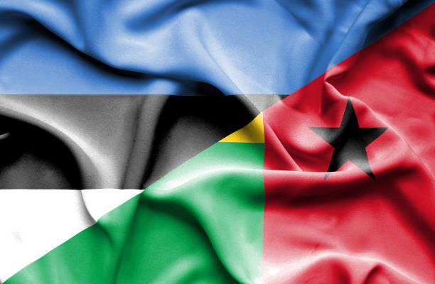 Waving flag of Guinea Bissau and Estonia vector art illustration