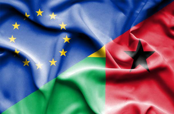 Waving flag of Guinea Bissau and EU vector art illustration
