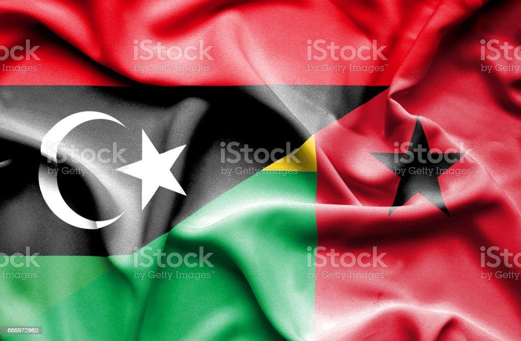 Waving flag of Guinea Bissau and Libya waving flag of guinea bissau and libya - immagini vettoriali stock e altre immagini di accordo d'intesa royalty-free