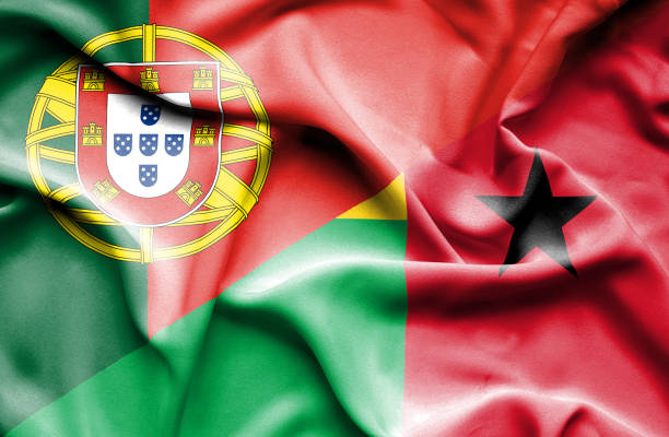 Waving flag of Guinea Bissau and Portugal vector art illustration