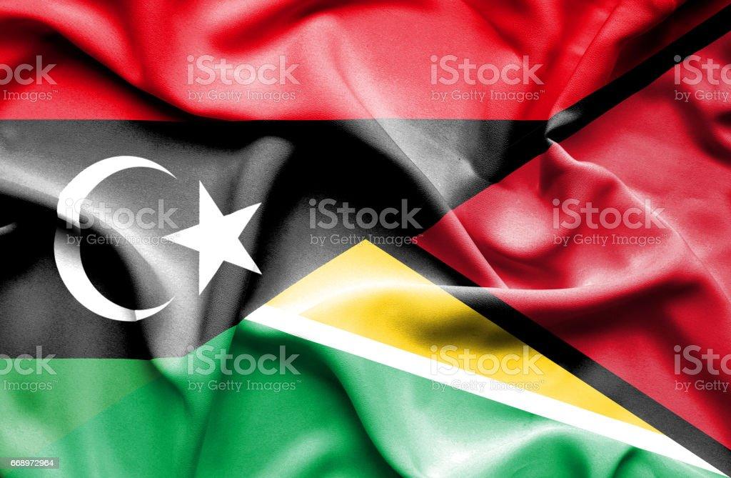 Waving flag of Guyana and Libya waving flag of guyana and libya - immagini vettoriali stock e altre immagini di accordo d'intesa royalty-free