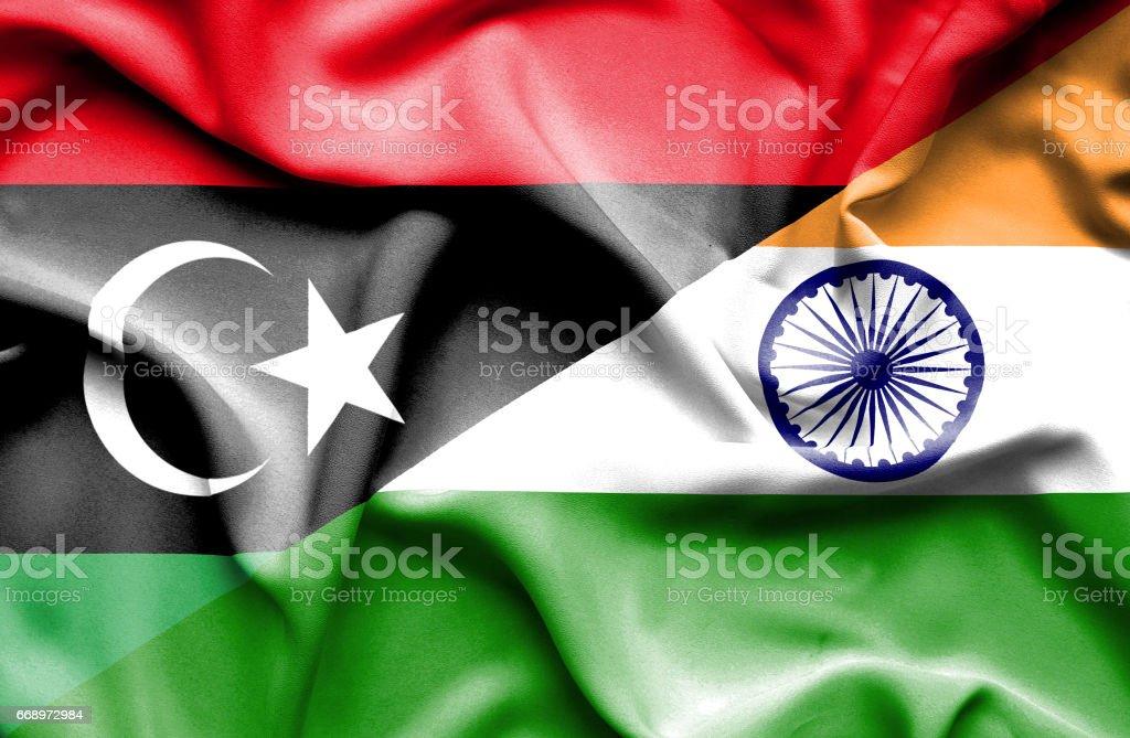 Waving flag of India and Libya waving flag of india and libya - immagini vettoriali stock e altre immagini di accordo d'intesa royalty-free