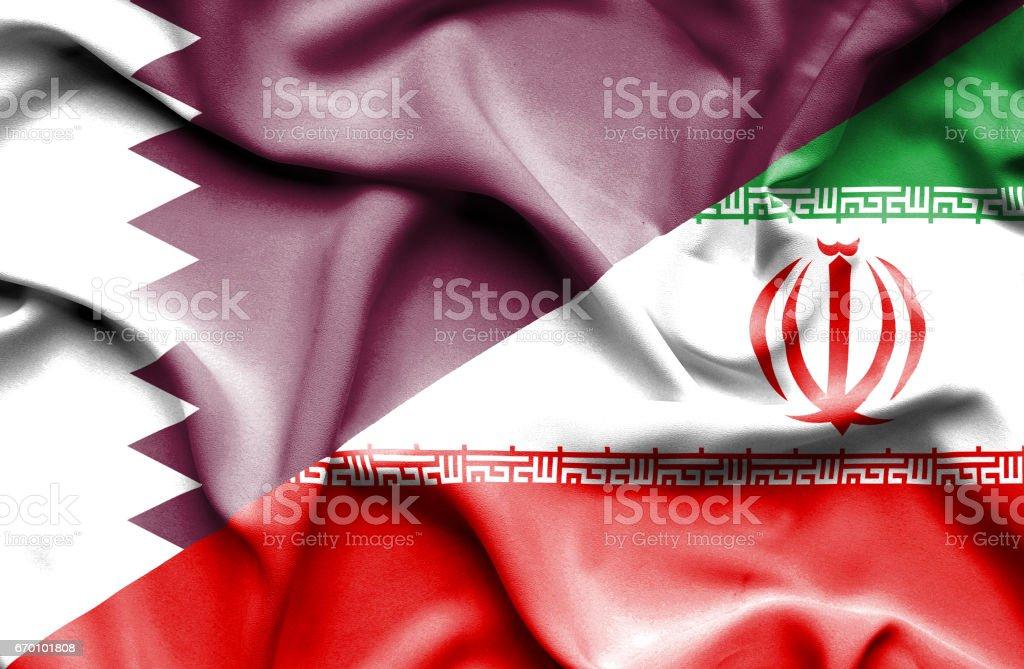 Waving flag of Iran and Qatar - ilustração de arte em vetor