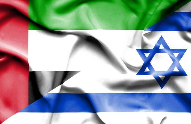 waving flag of israel and united arab emirates - uae flag 幅插畫檔、美工圖案、卡通及圖標