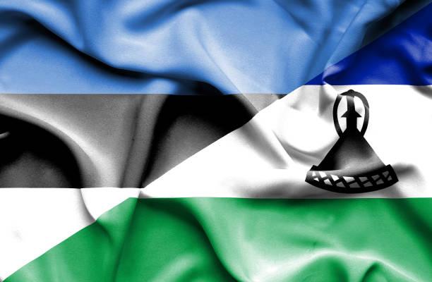 Waving flag of Lesotho and Estonia vector art illustration