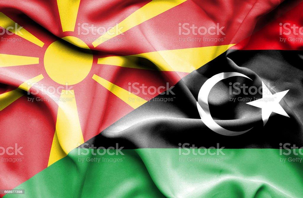 Waving flag of Libya and Macedonia waving flag of libya and macedonia - immagini vettoriali stock e altre immagini di accordo d'intesa royalty-free