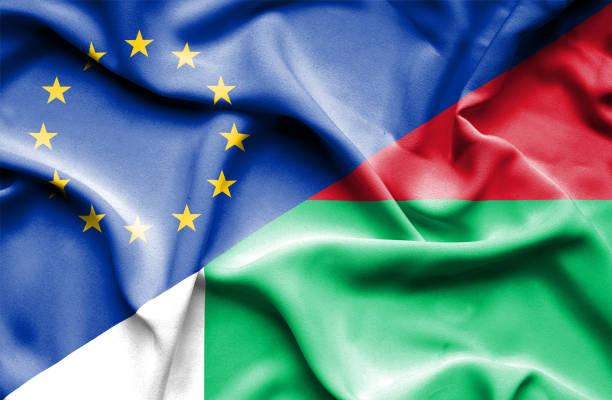Waving flag of Madagascar and EU vector art illustration