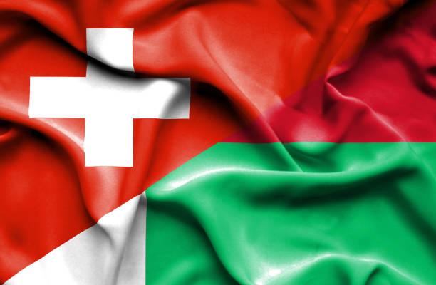 Waving flag of Madagascar and Switzerland vector art illustration
