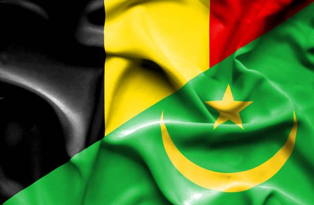 Waving flag of Mauritania and Belgium vector art illustration