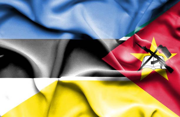 Waving flag of Mozambique and Estonia vector art illustration
