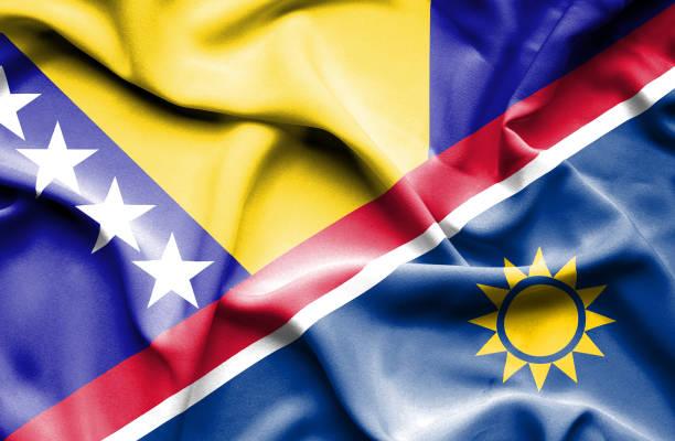 Waving flag of Namibia and Bosnia and Herzegovina vector art illustration
