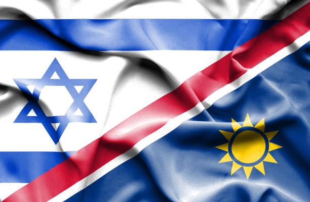Waving flag of Namibia and Israel vector art illustration