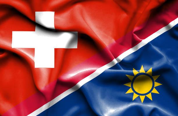 Waving flag of Namibia and Switzerland vector art illustration