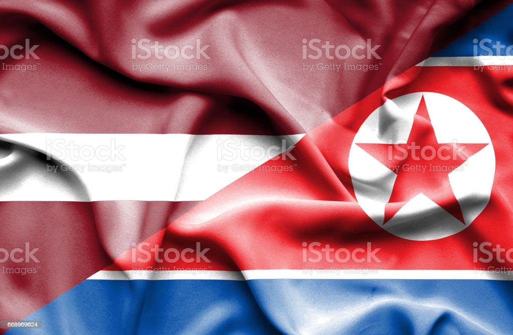 Waving flag of North Korea and Latvia waving flag of north korea and latvia - immagini vettoriali stock e altre immagini di accordo d'intesa royalty-free