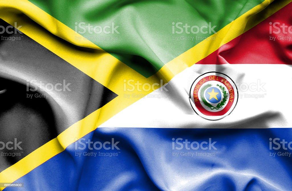 Waving flag of Paraguay and Jamaica waving flag of paraguay and jamaica - immagini vettoriali stock e altre immagini di accordo d'intesa royalty-free