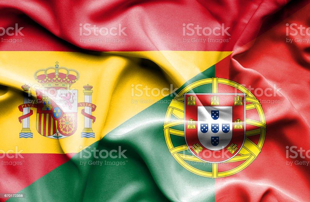 Waving flag of Portugal and Spain - ilustração de arte vetorial
