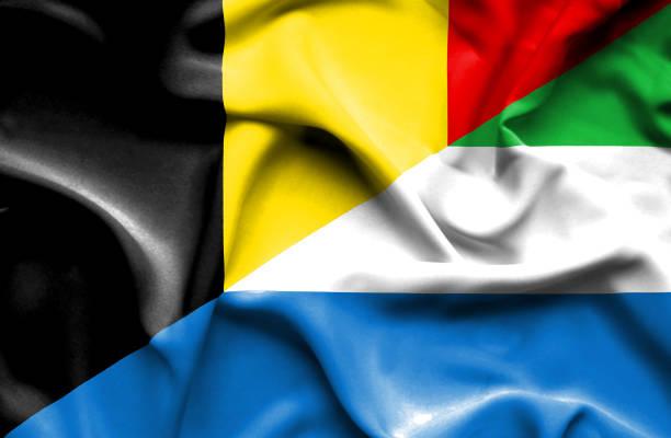 Waving flag of Sierra Leone and Belgium vector art illustration