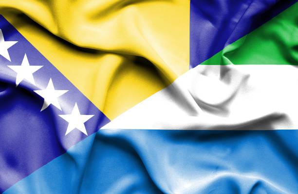 Waving flag of Sierra Leone and Bosnia and Herzegovina vector art illustration