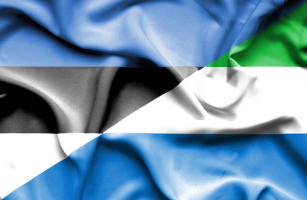 Waving flag of Sierra Leone and Estonia vector art illustration