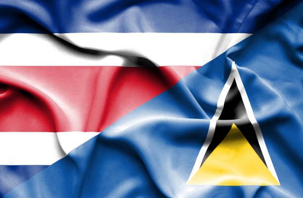 bildbanksillustrationer, clip art samt tecknat material och ikoner med viftande flagga st lucia och costa rica - lucia