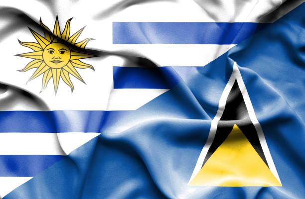 bildbanksillustrationer, clip art samt tecknat material och ikoner med waving flagga av st lucia och uruguay - lucia
