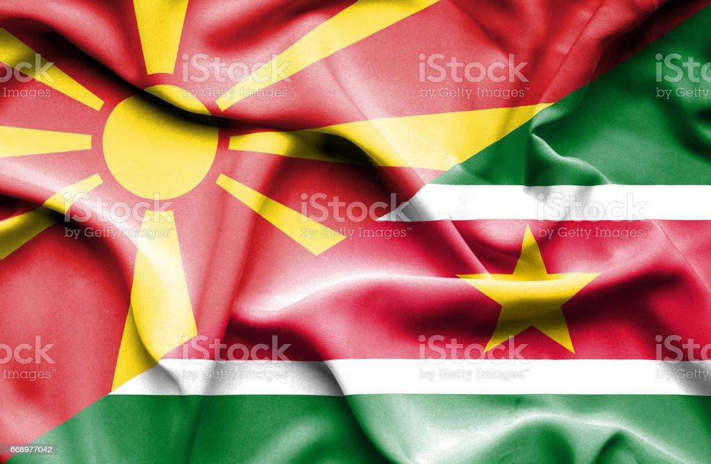 Waving flag of Suriname and Macedonia waving flag of suriname and macedonia - immagini vettoriali stock e altre immagini di accordo d'intesa royalty-free